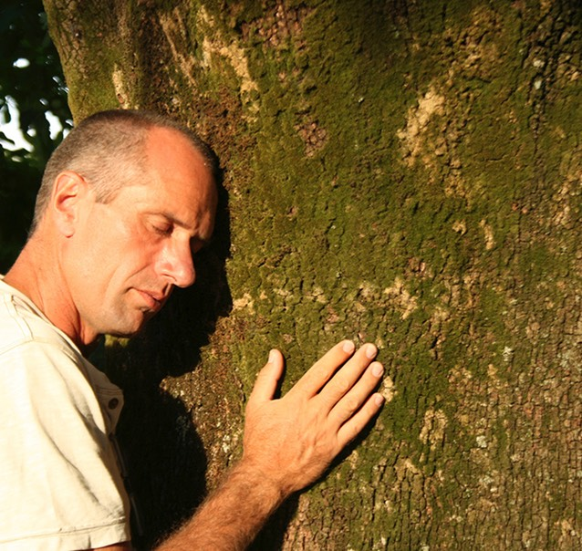 Andy Beer hugging tree